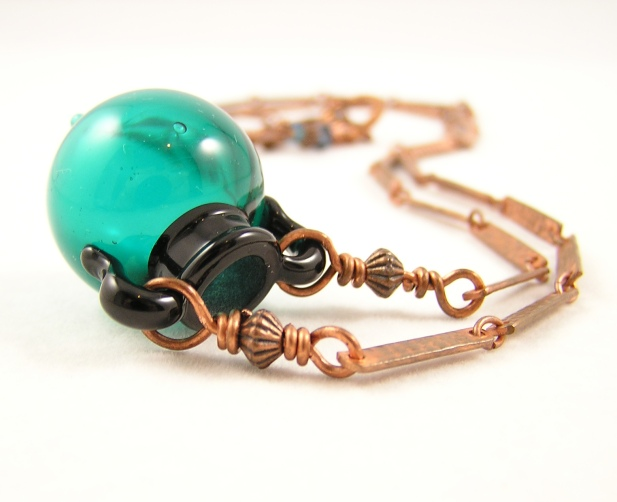 Glass urn and bronze necklace